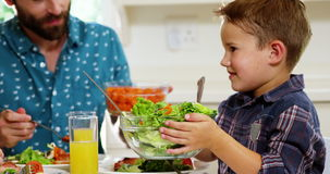 Boy giving the salad plate stock footage