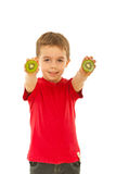 Boy giving slices kiwi Stock Images