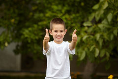Boy giving thumbs up Stock Photography