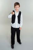 Boy giving thumbs up sign Royalty Free Stock Photo