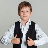 Boy giving thumbs up sign Royalty Free Stock Images