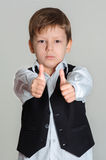 Boy giving thumbs up sign Stock Photos