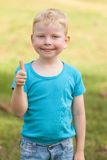 Boy Giving a Thumbs Up. Smiling cheerful boys show thumb up Royalty Free Stock Image