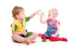 Boy giving to drink to a girl Royalty Free Stock Images