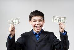Boy glad monetary awards Royalty Free Stock Photography