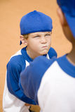 Boy glaring at another boy on baseball pitch Stock Photography