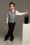 Boy with glass and champagne. Little boy with glass and champagne Royalty Free Stock Photography