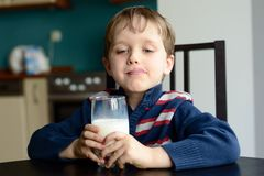 Boy with glass of delicious  milk. At home Royalty Free Stock Photography