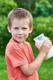Boy with glass jar of fresh milk Royalty Free Stock Photos