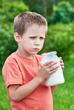 Boy with glass jar of fresh milk Royalty Free Stock Image