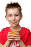 Boy with glass of juice. Cute smiling boy with glass of juice in his hands over white Stock Photography