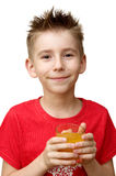 Boy with glass of juice. Smiling boy with glass of juice on white background Stock Photos