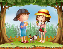 A boy with a glass of juice and a girl with an ice cream Royalty Free Stock Images