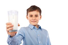 Boy with a glass of milk Stock Image
