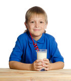 Boy with a glass of milk shake Royalty Free Stock Photography