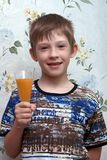 Boy with a glass of orange juice Royalty Free Stock Images