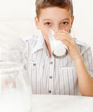 Boy with glass pitcher milk Royalty Free Stock Photography
