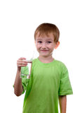 Boy with a glass of water Royalty Free Stock Photos