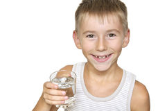 Boy with glass of water. Cute smiling boy with glass of water isolated on a white background Stock Photos