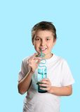 Boy with glass of water Stock Image