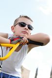 Boy with glasses on a bicycle Royalty Free Stock Photography