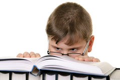 Boy in glasses with the book Royalty Free Stock Images