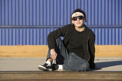 Boy with glasses in front of boxcar Stock Images