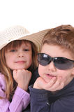 Boy with glasses and a girl with hat Royalty Free Stock Images