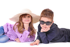 Boy with glasses and a girl with hat Royalty Free Stock Photography