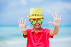 Boy in glasses and hat, sea beach Stock Photos