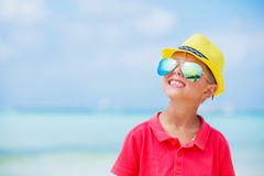 Boy in glasses and hat, sea beach Royalty Free Stock Photos