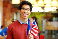 Boy in glasses holding flag of europe union and USA Stock Image