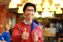 Boy in glasses holding flag of europe union with USA Stock Image