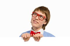 Boy with glasses holding a white placard Royalty Free Stock Photos