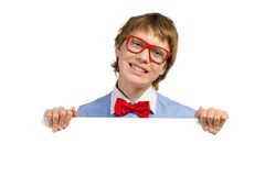Boy with glasses holding a white placard Royalty Free Stock Photography