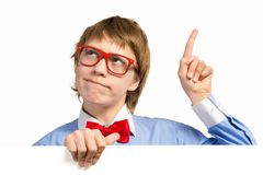 Boy with glasses holding a white placard Royalty Free Stock Images