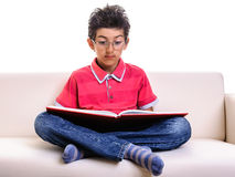 Boy in glasses learning Royalty Free Stock Images