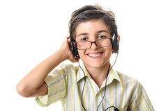 Boy in glasses listening music at headphones Stock Image