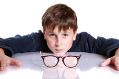 Boy with glasses and low vision Royalty Free Stock Photo