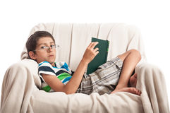 Boy in glasses reading book isolated Royalty Free Stock Images