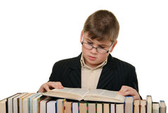 Boy in glasses reads book Royalty Free Stock Photography