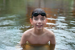 Boy with glasses in the river Royalty Free Stock Photo