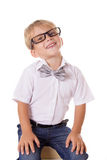 Boy in glasses sittting on pile of books Stock Images