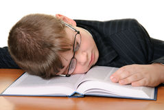 Boy in glasses sleeps on book Royalty Free Stock Photos