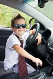 Boy with glasses and tie in car Stock Photography