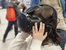 Boy with glasses of virtual reality, child tries new technology. Boy with glasses of virtual reality, the child tries new technology Royalty Free Stock Photography