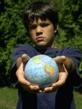 Boy and globe #2. Boy and globe different expression,focus on globe stock images