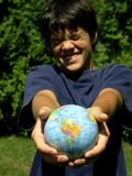 Boy and globe. Boy with funny face and globe,focus on globe stock photos