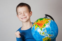 Boy with a globe royalty free stock photos