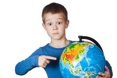 Boy with a globe Royalty Free Stock Image